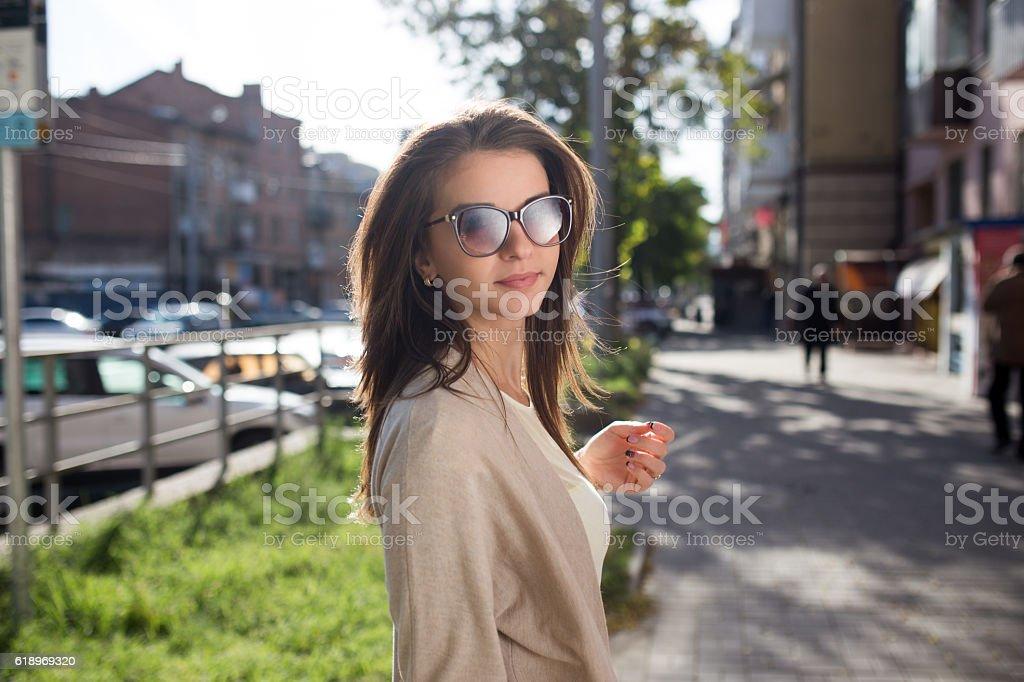 Young pretty woman outdoor fashion portrait. Beautiful girl casual dress stock photo