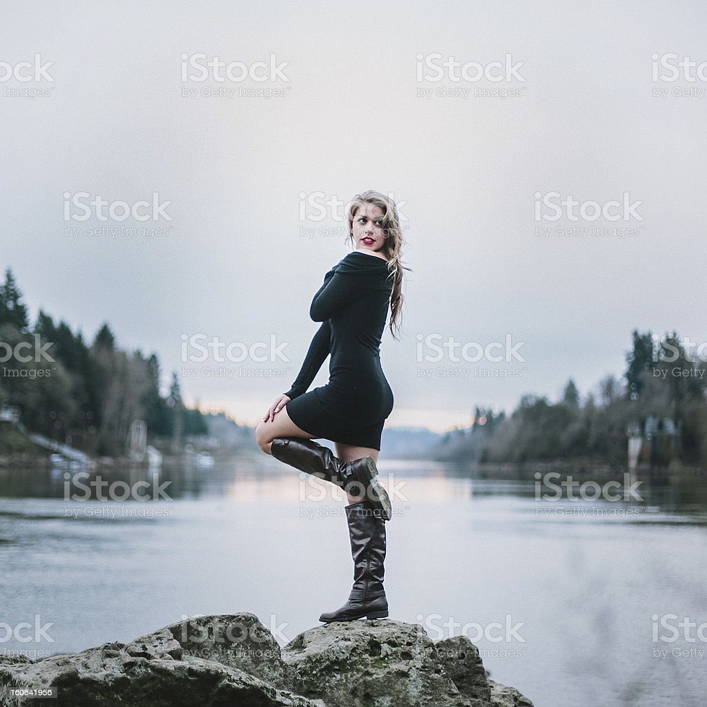 Young Pretty Woman Posing Near a River royalty-free stock photo