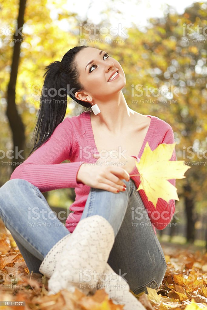 Young pretty woman rest in the autumn park royalty-free stock photo