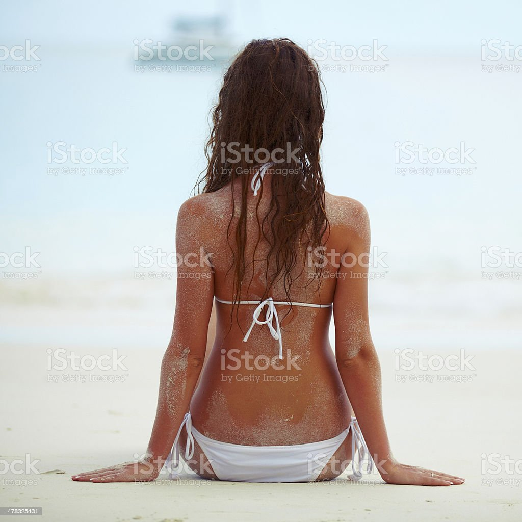 Young pretty woman resting on sand at beach royalty-free stock photo