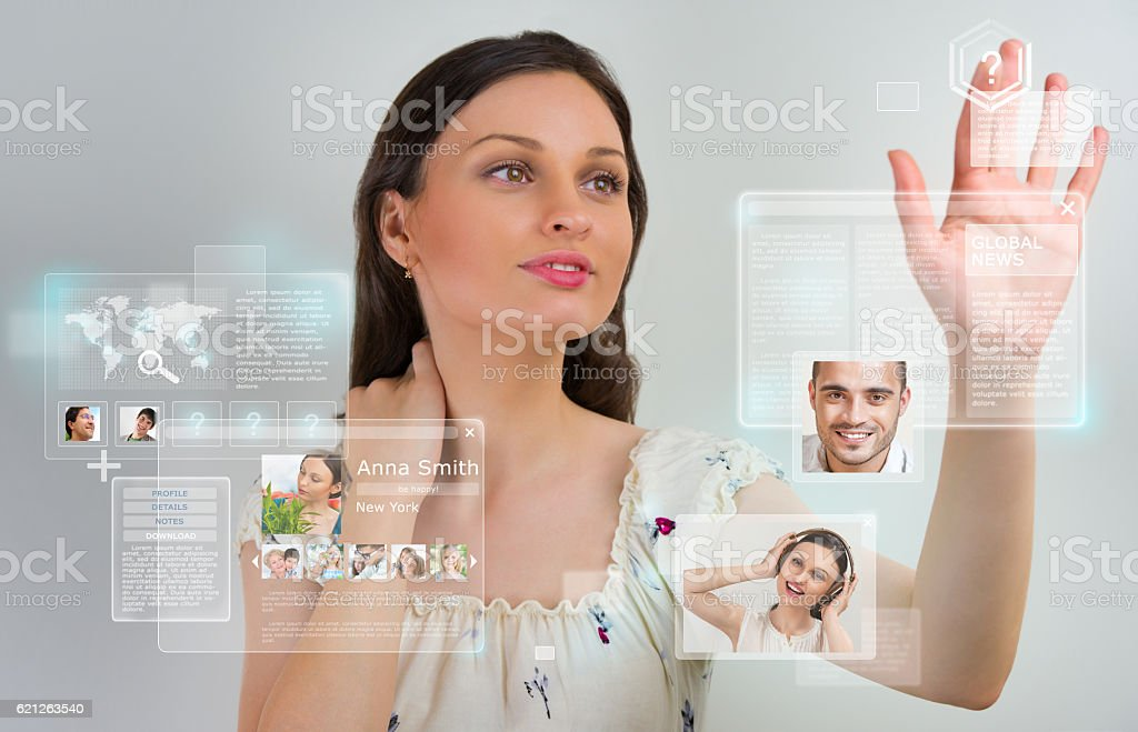 Young pretty woman using social media virtual interface stock photo