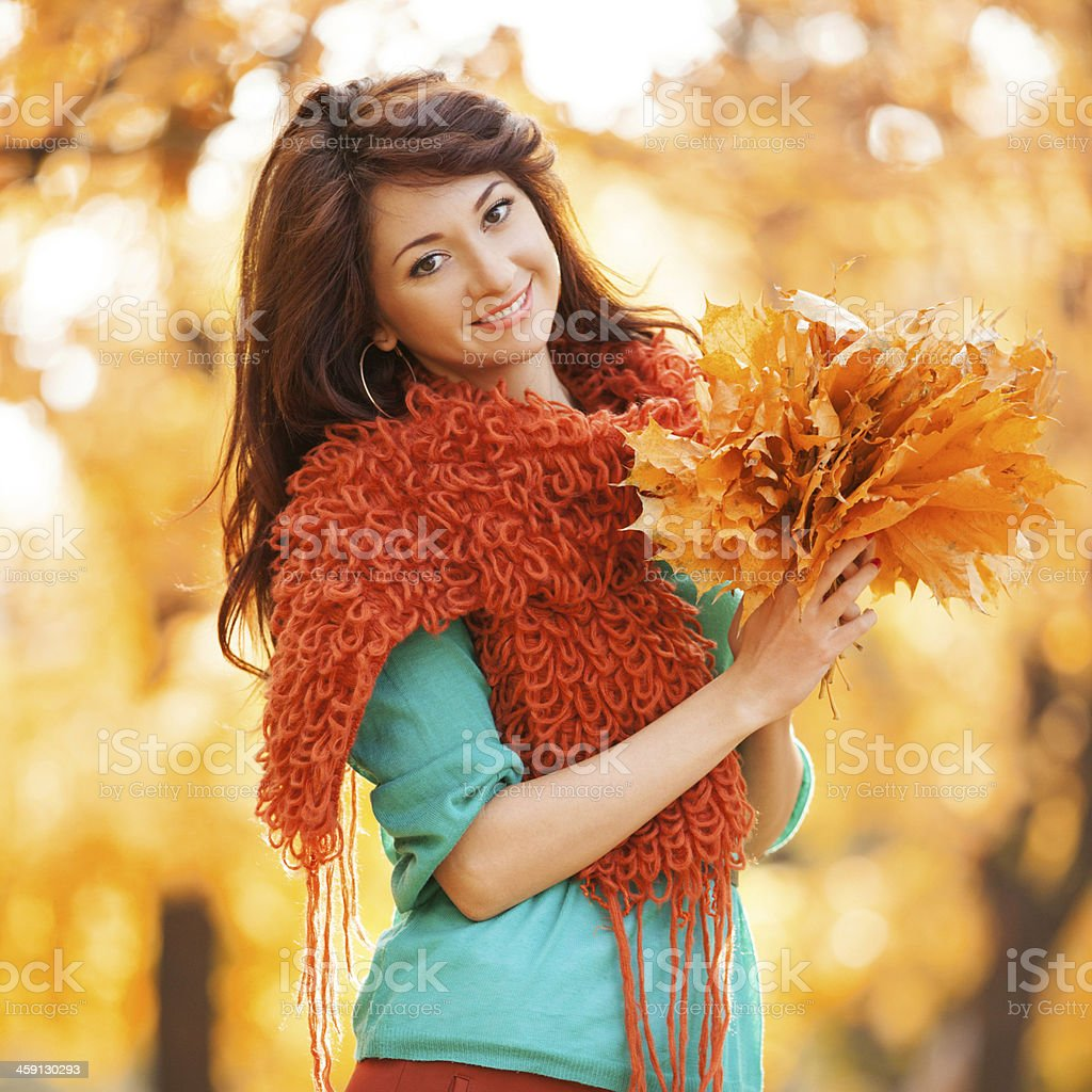 Young pretty woman walking in the autumn park royalty-free stock photo