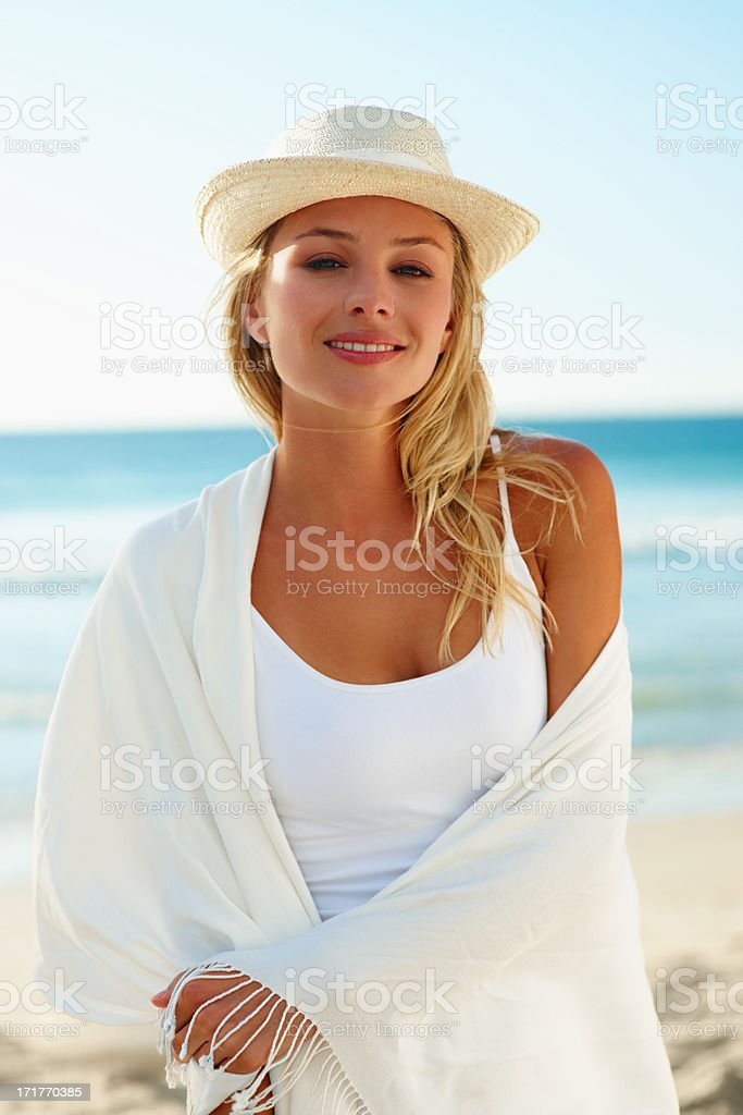 Young pretty woman wearing a shawl at the sea shore stock photo