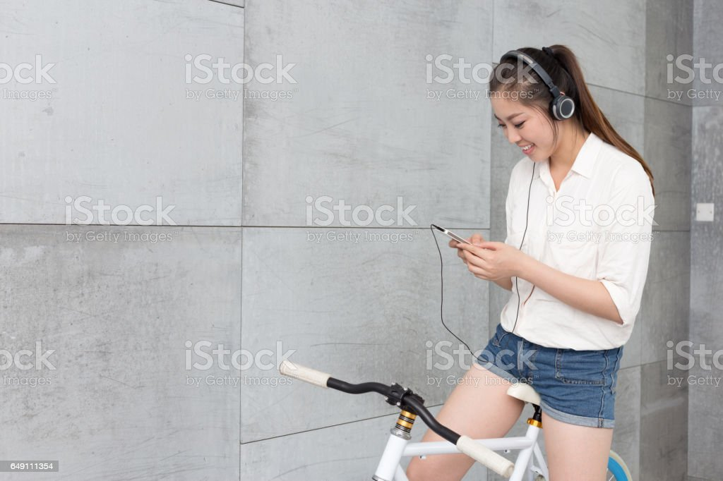 young pretty woman with bike stock photo