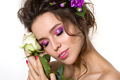 Young pretty woman with bright pink makeup