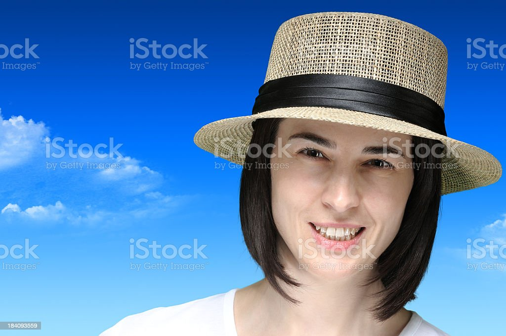 Young pretty woman with straw hat stock photo