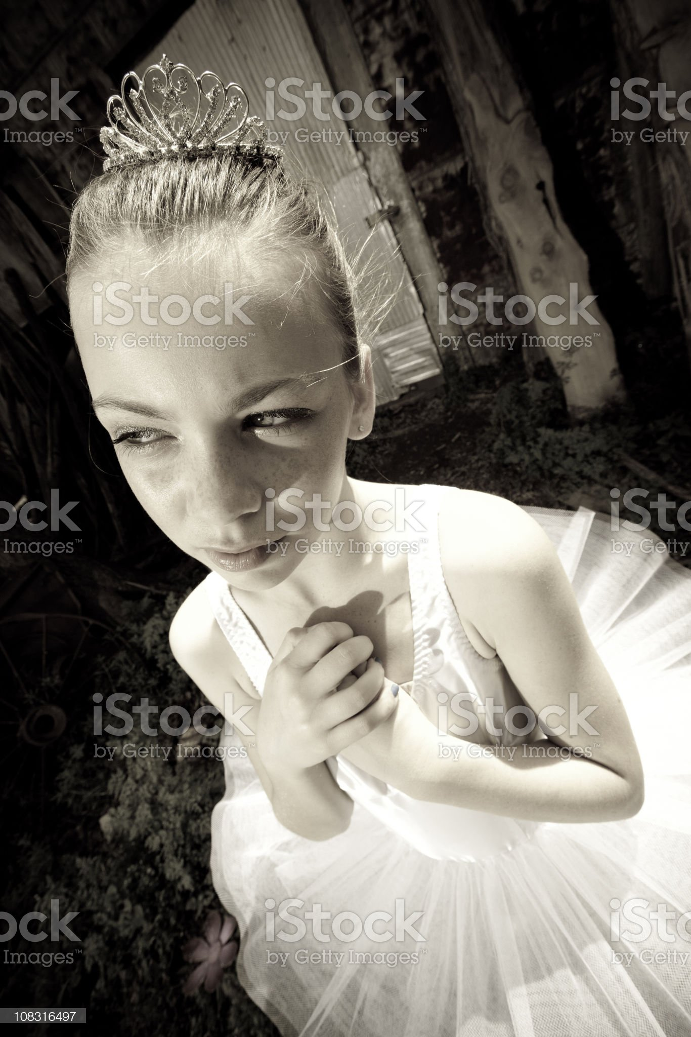 Young Princess Holding Her Hands to Chest royalty-free stock photo