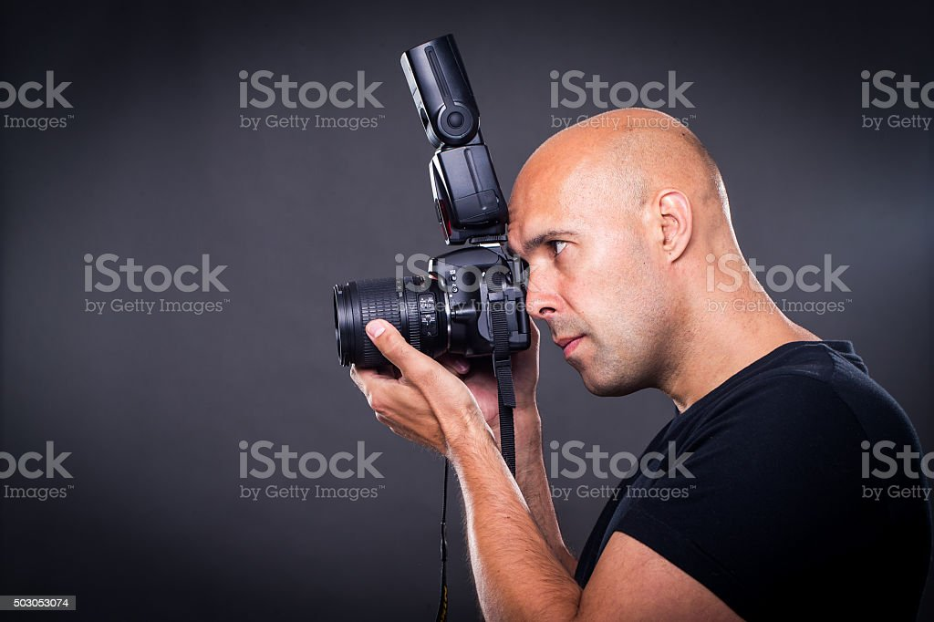 Young, pro male photographer in his studio stock photo