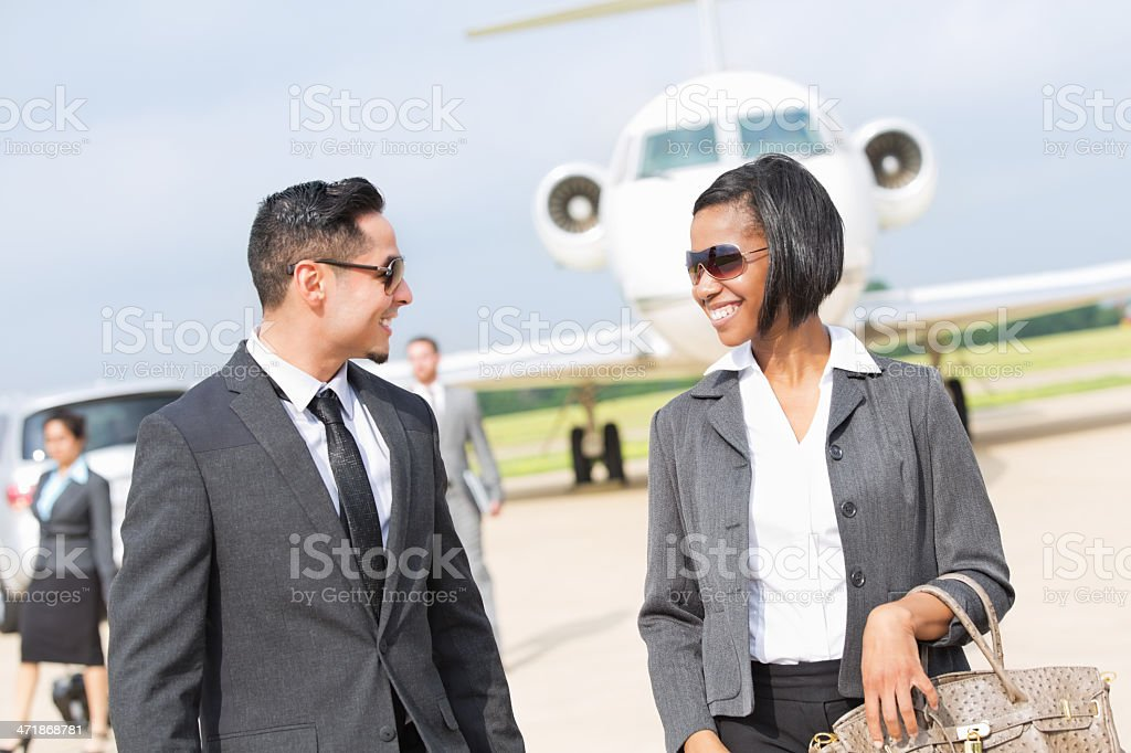 Young professional business people meeting after deboardring private jet royalty-free stock photo