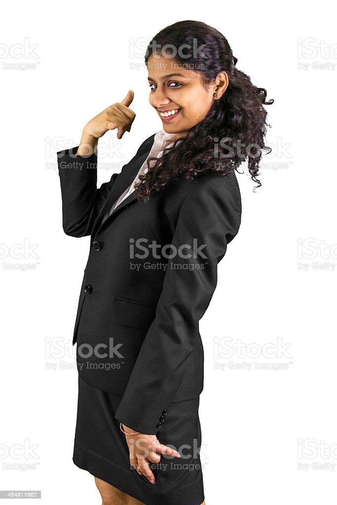 Young professional business woman gesturing to call her. stock photo