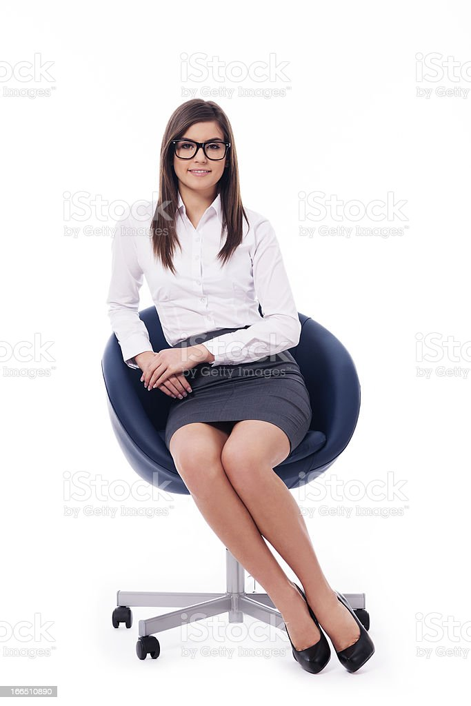 Young professional businesswoman sitting on a chair royalty-free stock photo