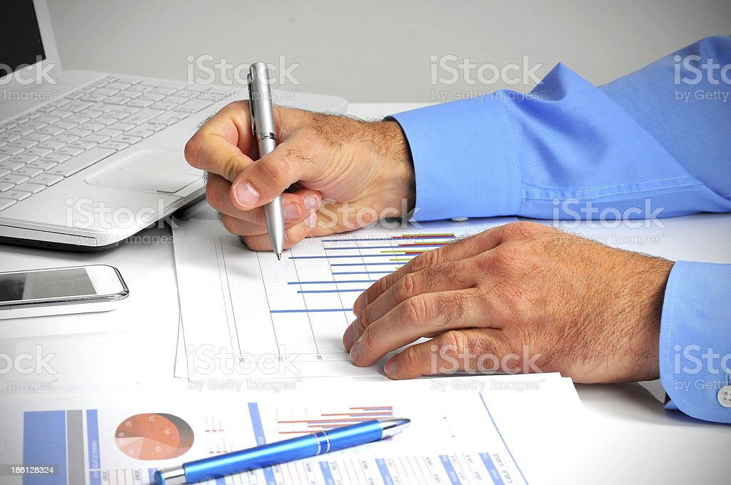 Young professional caucasian businessman with taxes and finances in office royalty-free stock photo