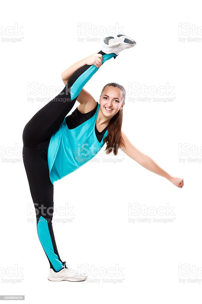 Young professional cheerleader  stands in vertical splits. Isolated over white. stock photo