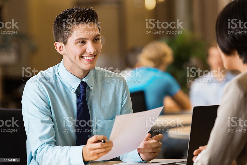 Young professional college student with resume at job interview royalty-free stock photo