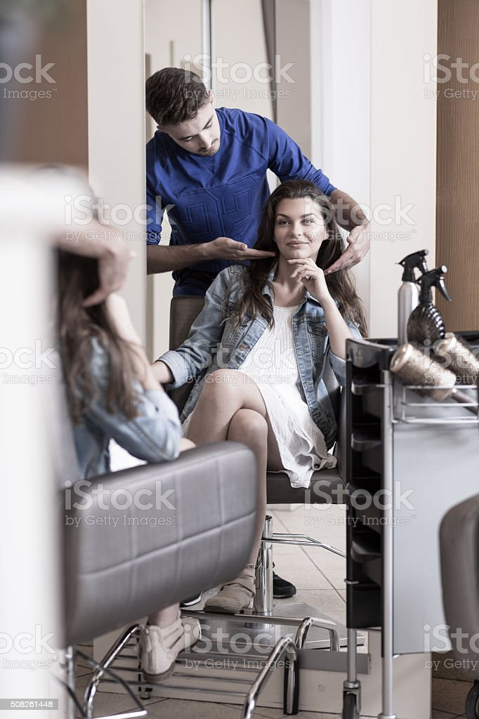 Young professional hairdresser stock photo