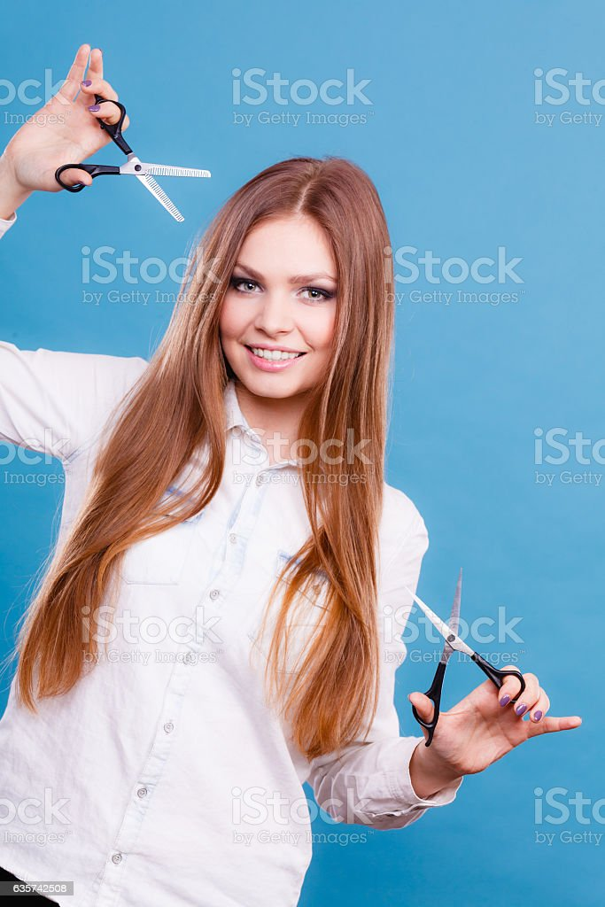 Young professional hairdresser with scissors. stock photo