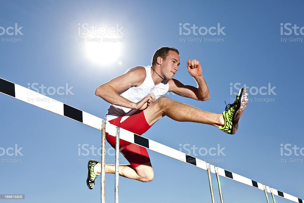young professional hurdler stock photo