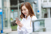 Young Professional Japanese Woman Texting on Mobile Phone Tokyo Japan
