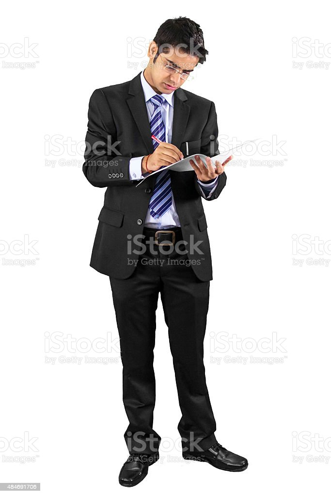 Young professional signing on papers. stock photo
