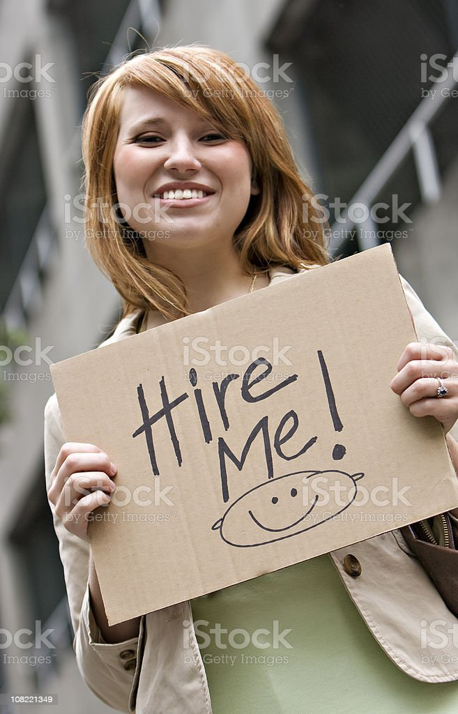 Young Professional Woman Holding Hire Me Sign royalty-free stock photo