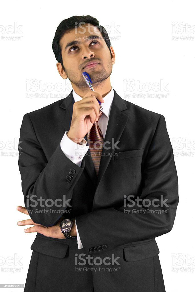 Young professional writer in thinking mood stock photo