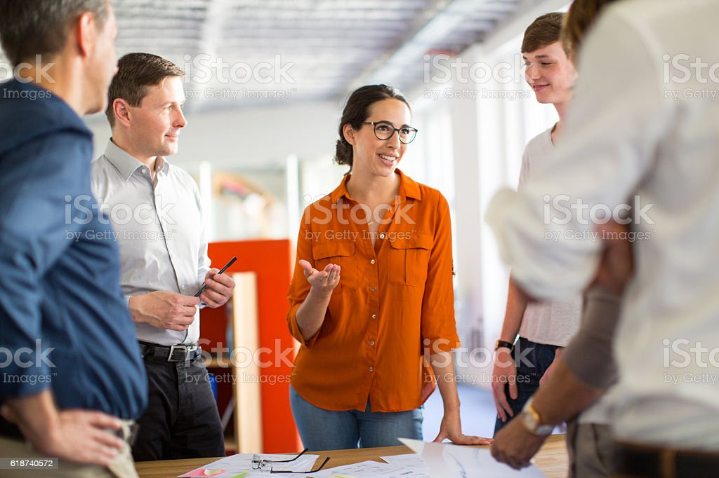 Young professionals meeting around a table stock photo