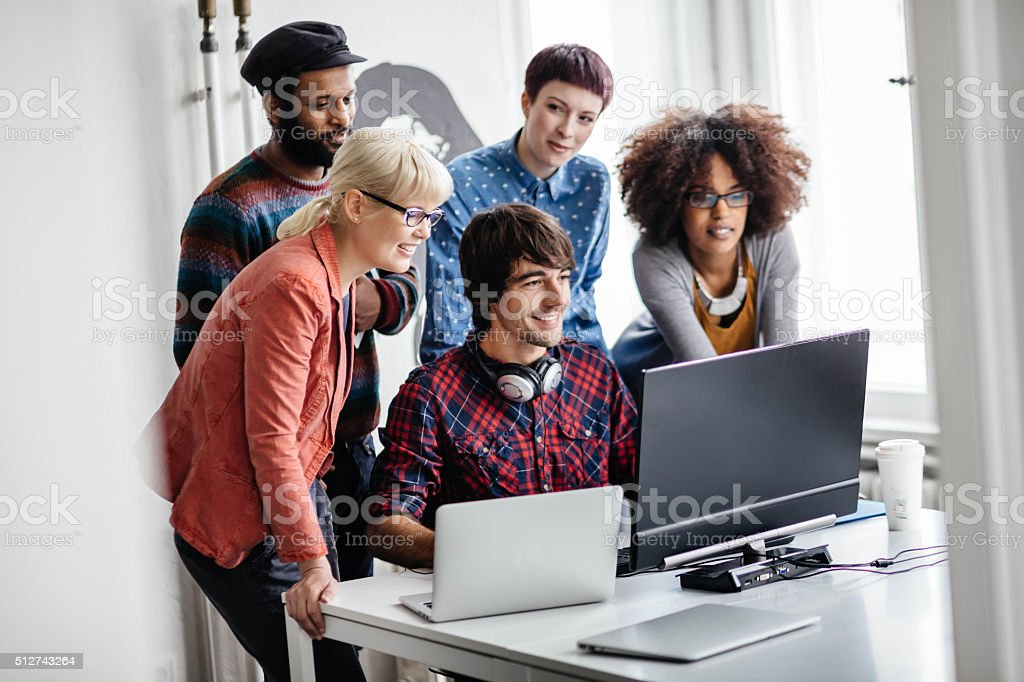 Young professionals working together on new project stock photo