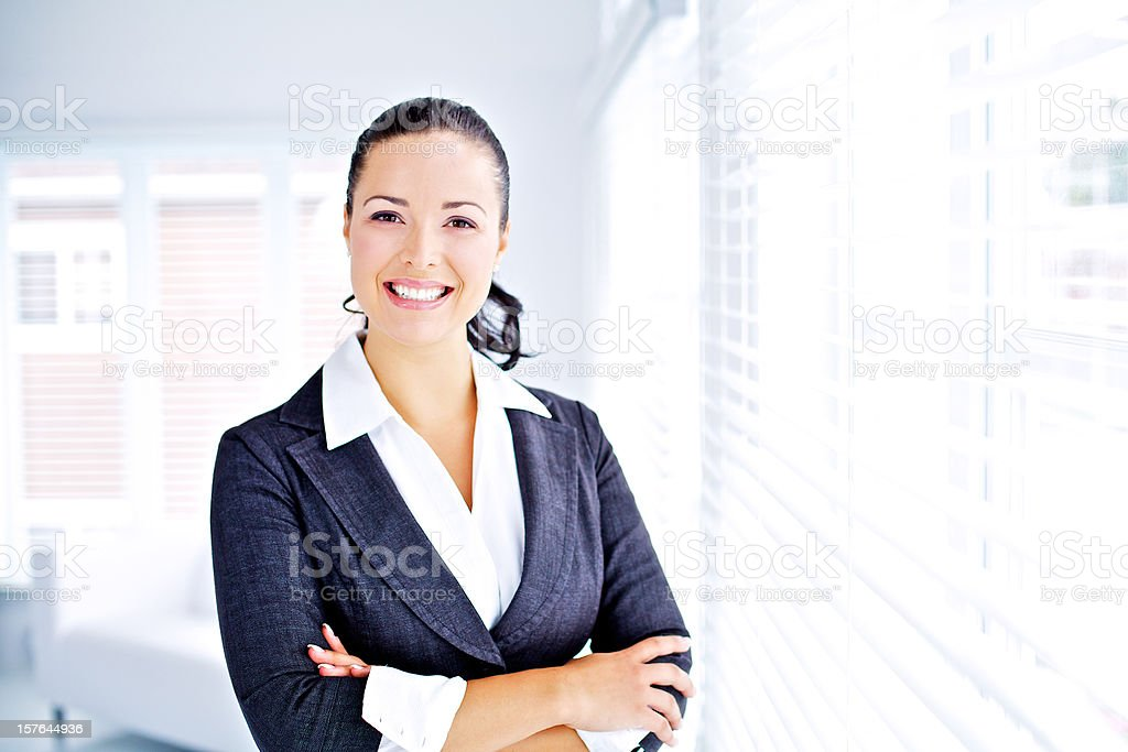 young professionnal women smiling and looking at the camera royalty-free stock photo