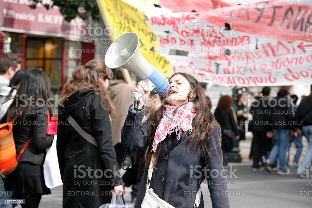Young protestor with megaphone stock photo