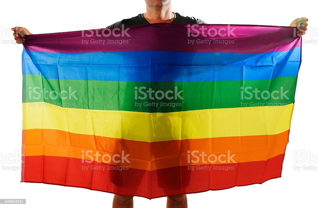 young proud gay man spreading wide big pride homosexual flag stock photo