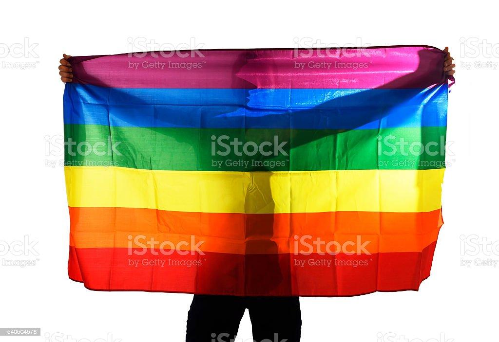 young proud gay man spreading wide big pride homosexual flag stock photo
