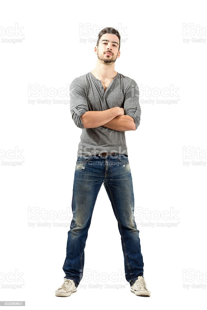 Young proud satisfied man with crossed arms looking at camera stock photo