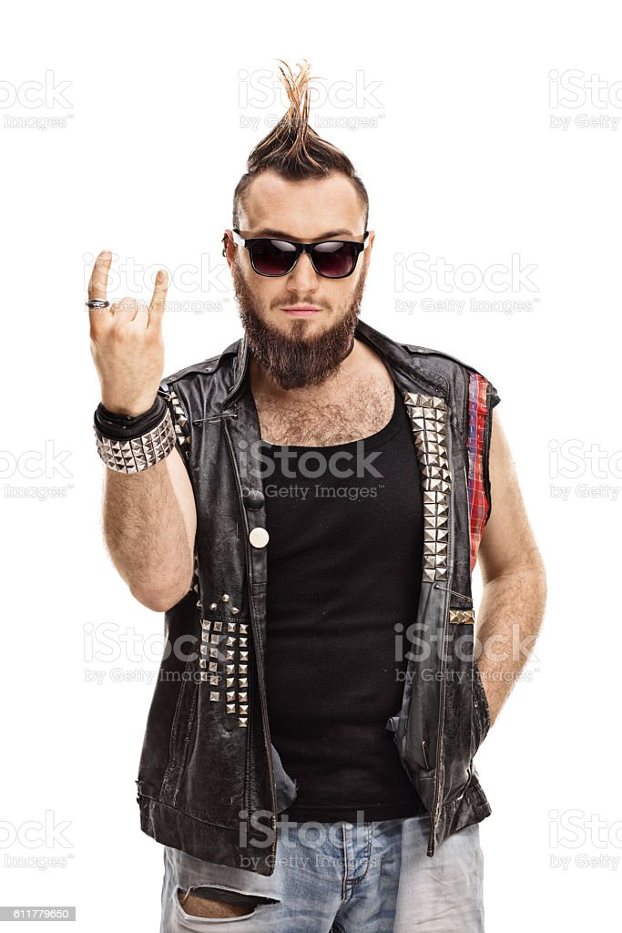 Young punker doing a rock hand gesture stock photo