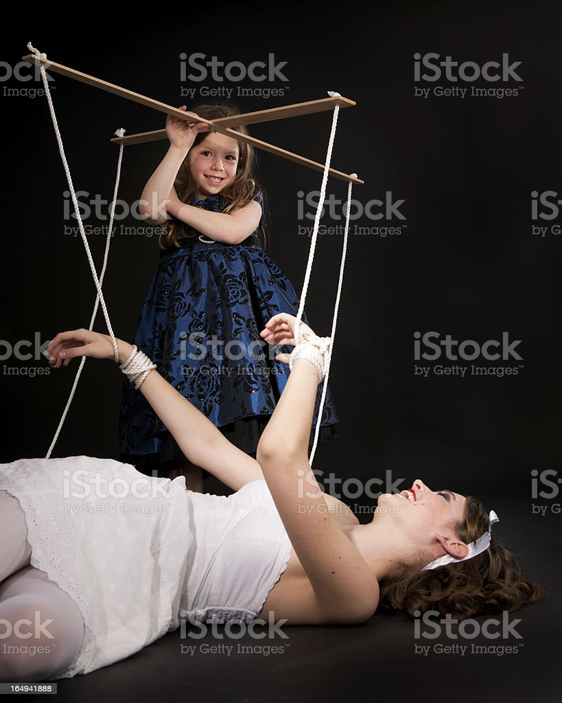Young Puppeteer and Human Marionette Doll stock photo
