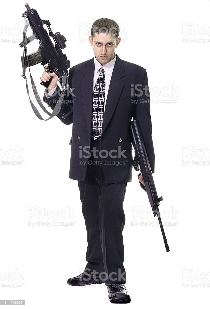 Young purposeful manager with dollars in pocket and weapon royalty-free stock photo