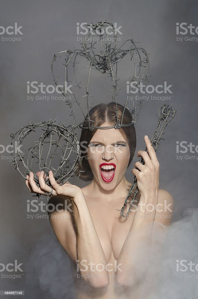 Young queen in fog with symbols power of wire stock photo