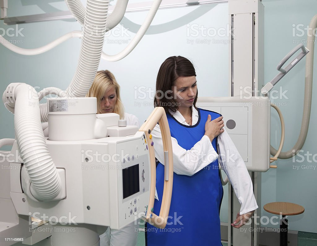 Young radiologist prepairing fow work,wearing protective suit royalty-free stock photo