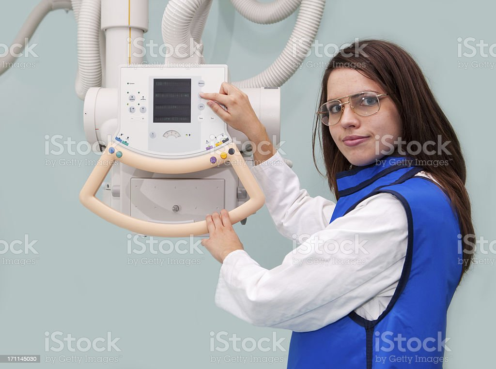 Young radiologist working with modern X-ray machine stock photo