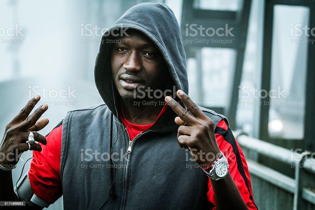 Young rapper on iron bridge stock photo