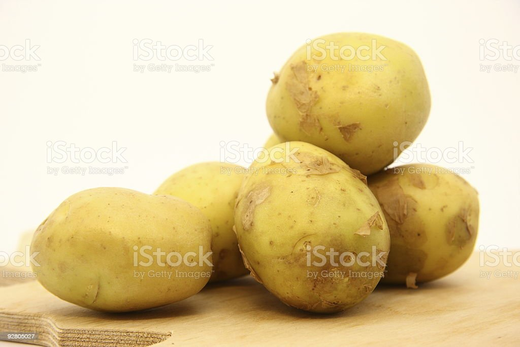Young raw potatoes. stock photo