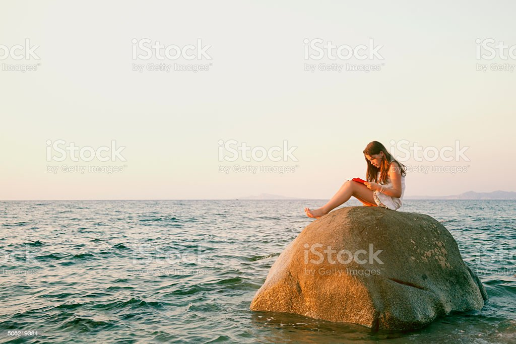 Young reader in romantic environtment stock photo