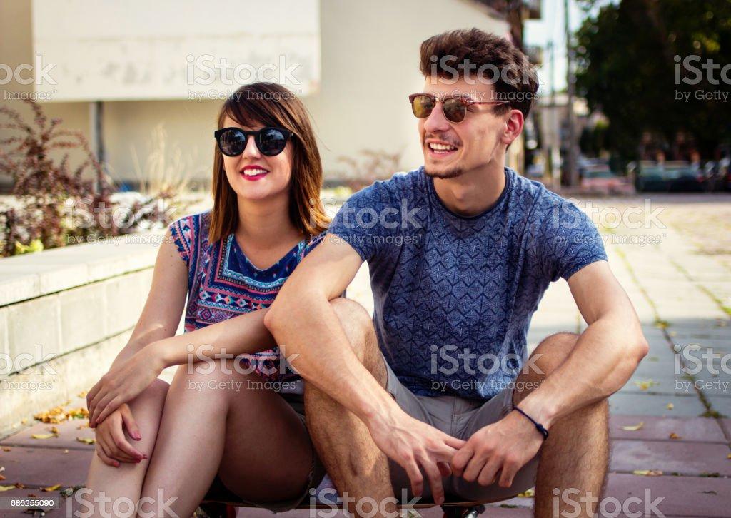 Young rebel couple having fun outdoor stock photo