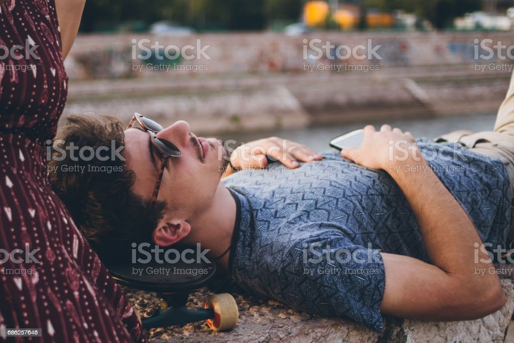 Young rebellious hipster couple outdoor stock photo