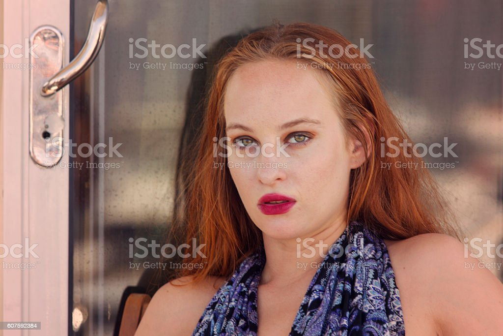 Young red haired irish female model posing in istanbul turkey stock photo