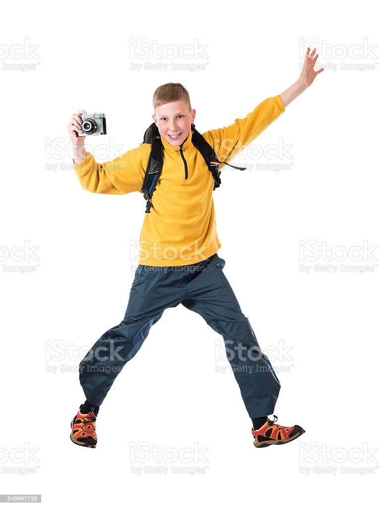 Young red-haired boy in a yellow jacket and a backpack stock photo