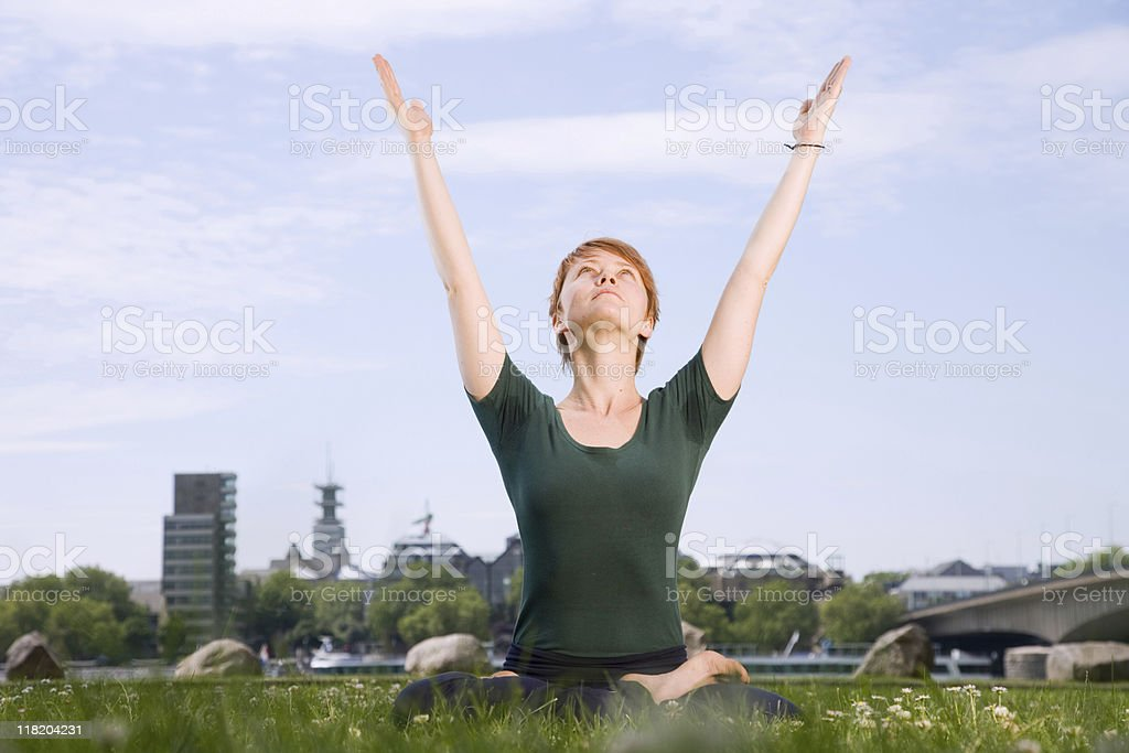 Young Redhaired Woman Practicing Yoga In The City royalty-free stock photo