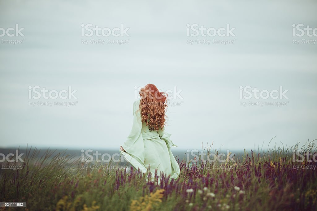 Young redhead girl in medieval dress stock photo