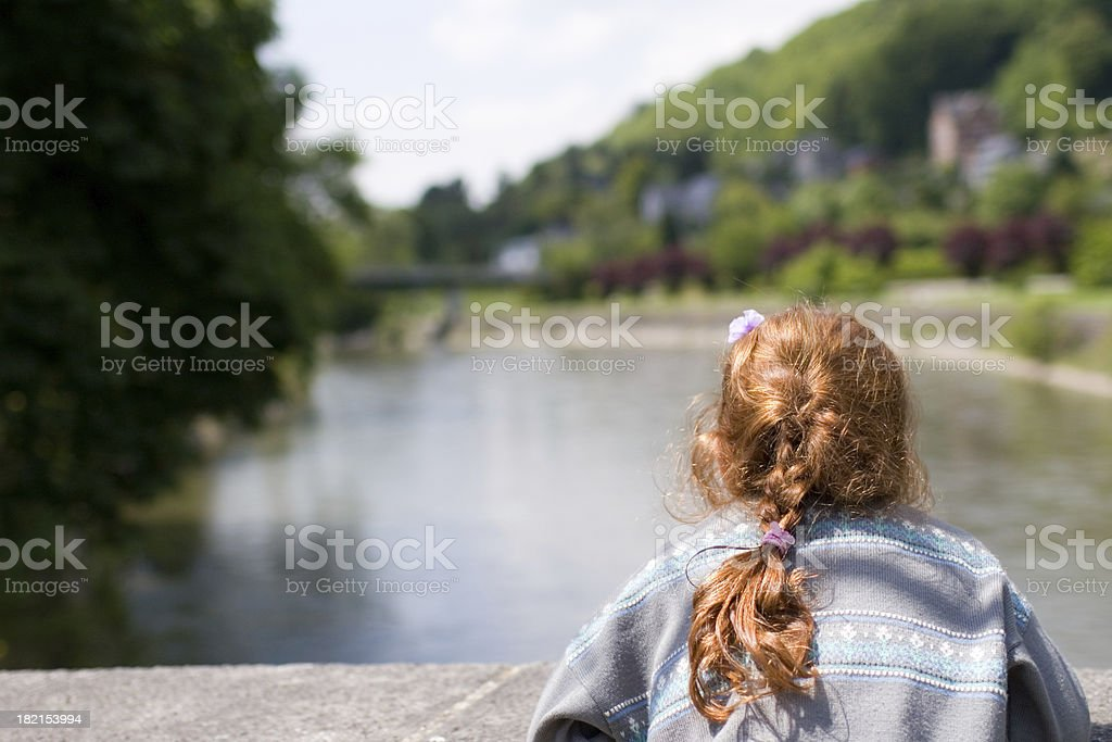'Young redhead girl on bridge, admiring the view' stock photo