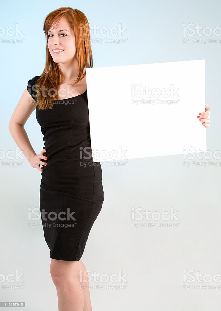 Young Redhead Woman Holding a Blank White Sign royalty-free stock photo