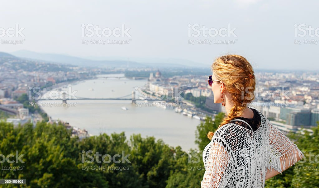 Young redhead woman posing with Budapest panorama stock photo